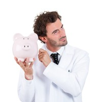 Scientist with piggy bank